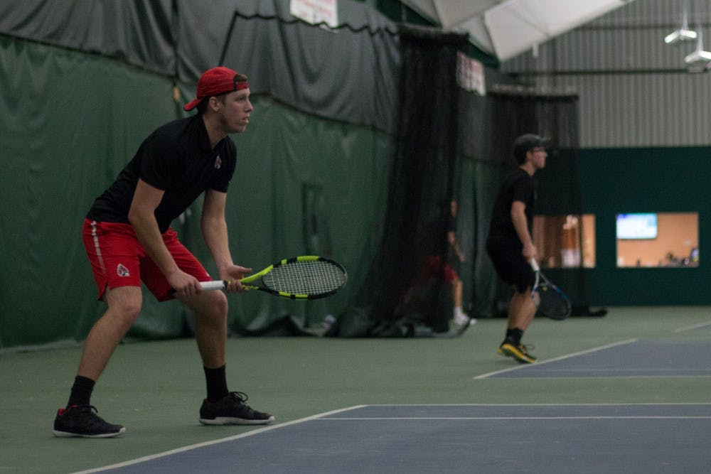 <p>Redshirt junior Collin Rigney set to return a serve in his singles match against IU Southeast at Northwest YMCA in Muncie, Ind. Feb. 3. <strong>Eric Pritchett, DN</strong></p>