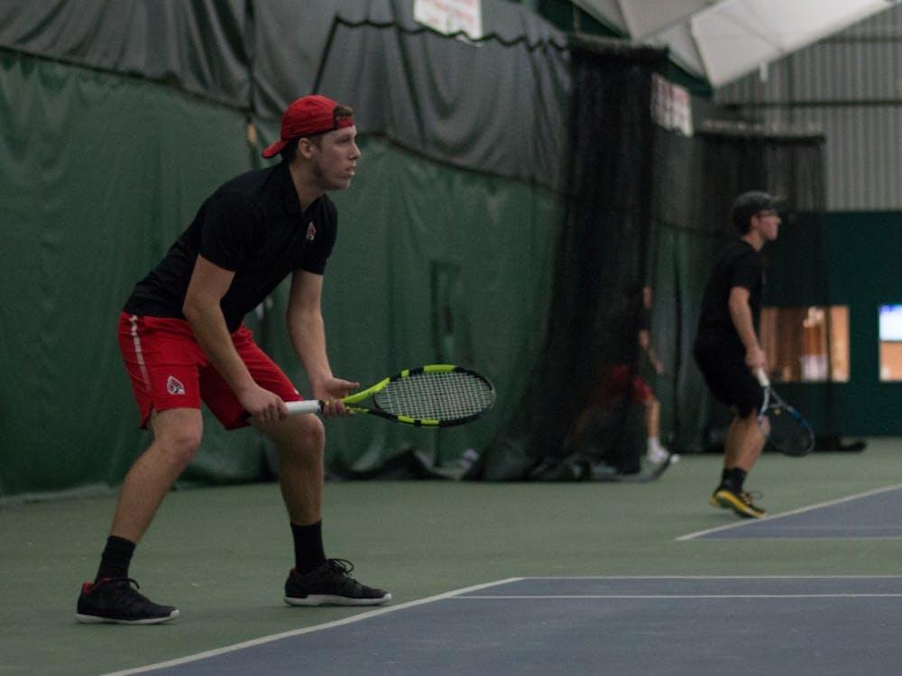 Redshirt junior Collin Rigney set to return a serve in his singles match against IU Southeast at Northwest YMCA in Muncie, Ind. Feb. 3. Eric Pritchett, DN