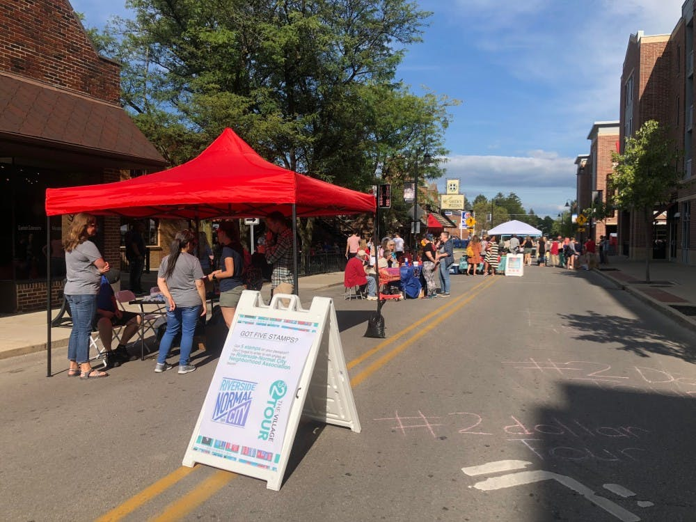 Several shops in the village set up tables outside their storefronts for students to shop at for the inaugural $2 Tour of the Village.