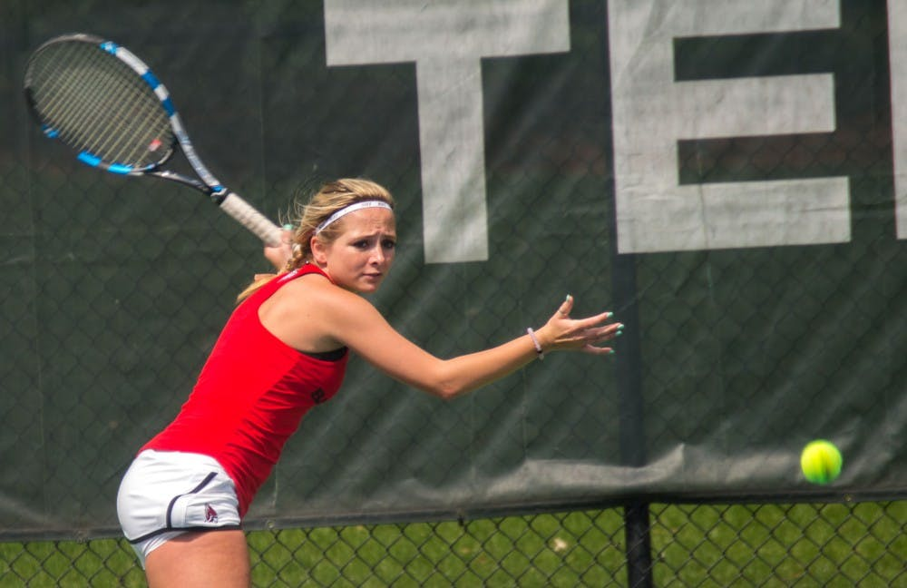 <p>Junior Peyton Gollhofer gets ready to return the ball during the match against Buffalo on April 2, 2017 at the Cardinal Creek Tennis Center. <strong>Terence K. Lightning Jr., DN File</strong></p>