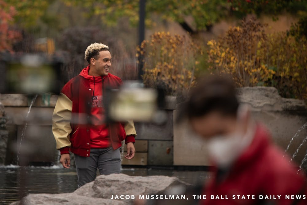 Ball State redshirt linebacker Brandon Martin stands in the Frog Baby fountain, Oct. 20, 2020, at Ball State University. Ball State Alumnus David Letterman and former Indianapolis Colts quarterback Peyton Manning were seen filming on campus by Frog Baby and at Scheumann Stadium. Jacob Musselman, DN