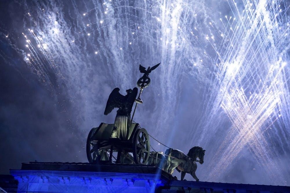 Fireworks are seen over the Brandenburg Gate as part of the 30th anniversary of the fall of the Berlin Wall in Berlin, Germany, Saturday, Nov. 9, 2019. (Bernd von Jutrczenka/dpa via AP)