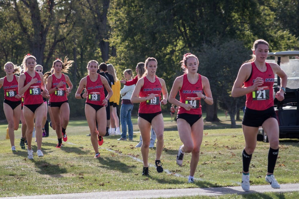 <p>A pack of Ball State Cross Country runners stick together in the first kilometer of their meet Oct. 18, 2019, at the Muncie Elks Golf Club. The Cardinals won with runners finishing in the first six positions. <strong>Eric Pritchett, DN</strong></p>