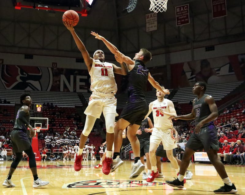 Ball State redshirt freshman guard Jarron Coleman goes for a layup while being guarded by Defiance freshman guard Chase Glock during the Cardinals' game against the Yellow Jackets Tuesday, Nov. 5, 2019, at John E. Worthen Arena. Ball State won 87-43. Paige Grider, DN