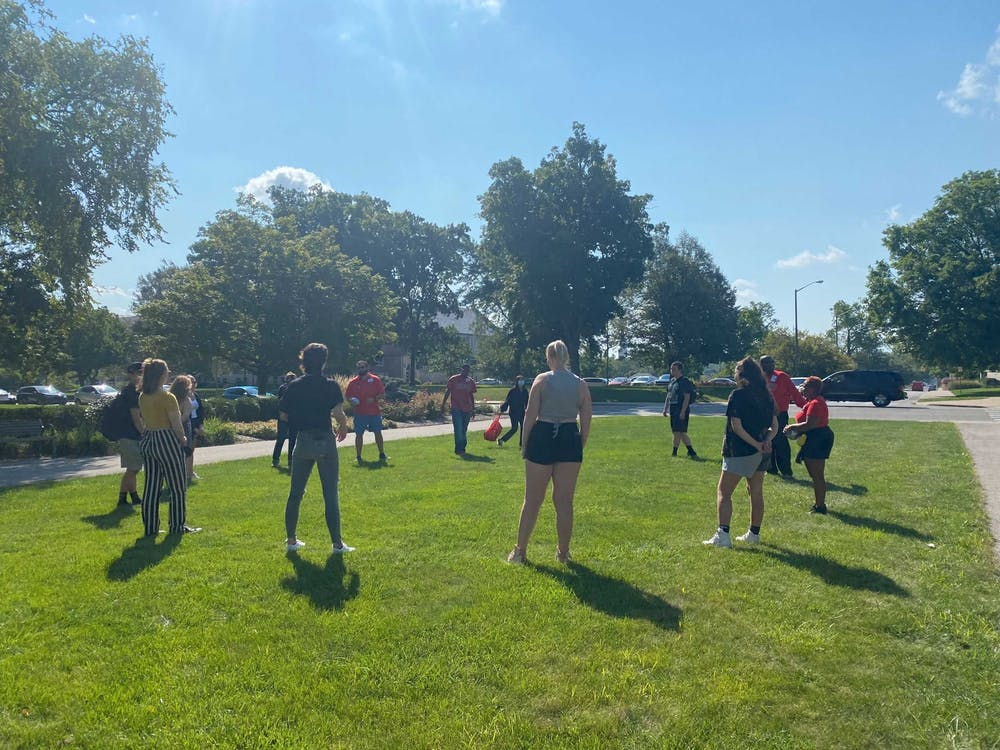 """Participants in the """"We Soar"""" Day of Dialogue stand in front of Beneficence Sept. 14. The kickoff event aimed to encourage conversation about diversity in classrooms between faculty, staff and students. Mackenzie Rupp, DN"""