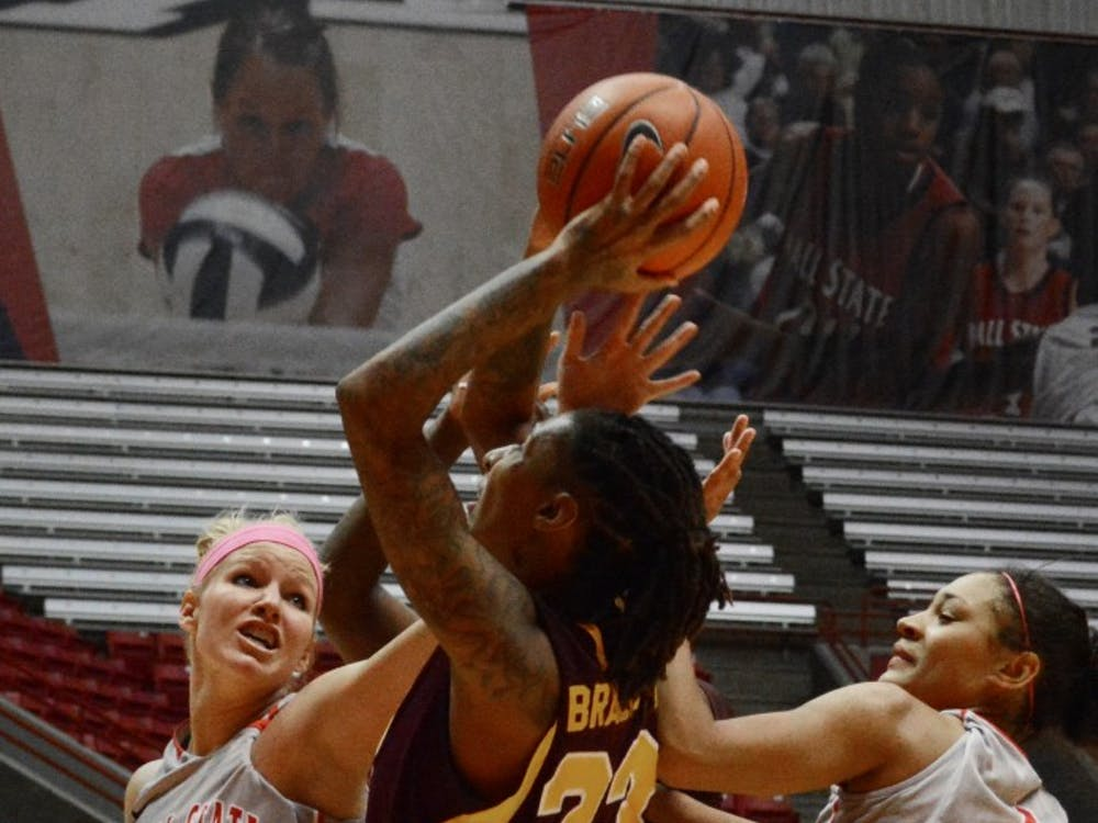 Ball State's Katie Murphy reaches behind to block Central Michigan's Crystal Bradford from scoring a basket Feb. 6 in Worthen Arena. DN PHOTO SAMANTHA BLANKENSHIP