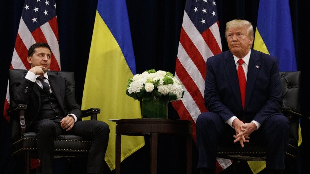 "In this Sept. 25, 2019, file photo, President Donald Trump meets with Ukrainian President Volodymyr Zelenskiy at the InterContinental Barclay New York hotel during the United Nations General Assembly, in New York. It's the story of a president who either had a ""perfect phone call"" with Ukraine or abused his power and should be removed from office. What to watch as presidential impeachment arguments get underway in the Senate for only the third time in American history. (AP Photo/Evan Vucci, File)"