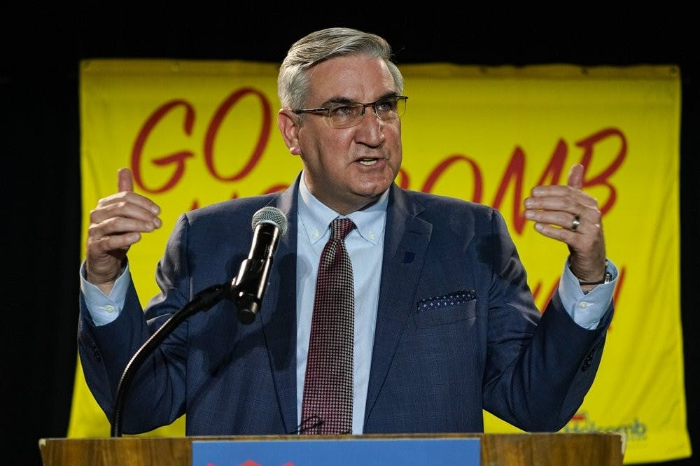 Indiana Gov. Eric Holcomb addresses supporters after winning his second term as governor in Indianapolis, Tuesday, Nov. 3, 2020. (AP Photo/Michael Conroy)