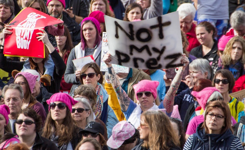 An estimated 4,500 to 5,000 people gathered outside the Indiana Statehouse on Jan. 21 for the Indianapolis Women's March, according to Indiana State Police. The rally was held in conjunction with hundreds of marches nationwide to protest the presidency of Donald Trump and support the rights of women, immigrants, LGBTQ and people of various religions. Grace Ramey // DN