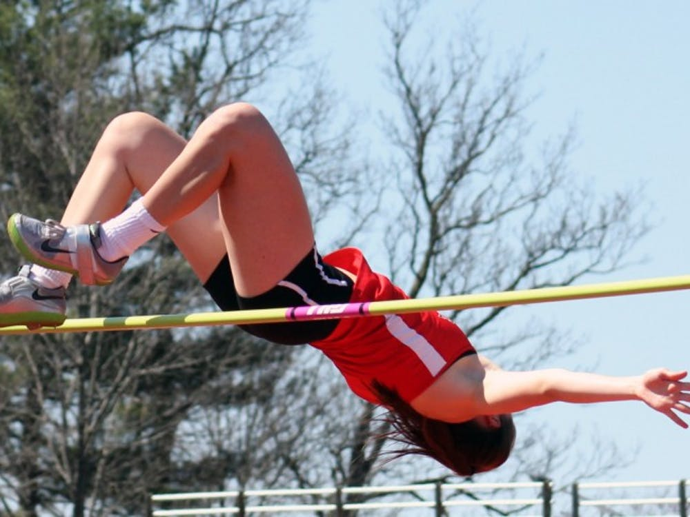 Freshman Regan Lewis clears the bar in the high jump at the Ball State Challenge at the Briner Sports Complex on Saturday, April 16, 2016. DN PHOTO ALLYE CLAYTON