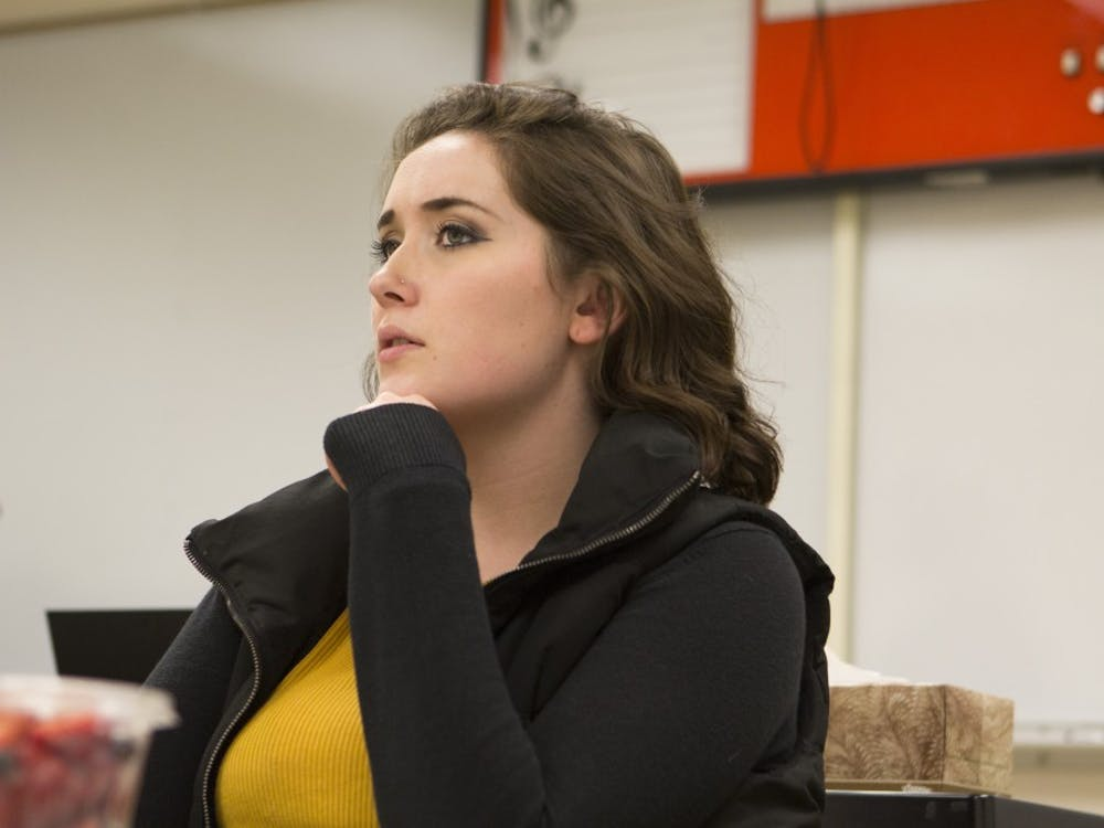 """Junior theater education and directing major Baily Fritz watches a rehearsal of """"Bully"""" the night before the show opens. Emma Rogers // DN"""