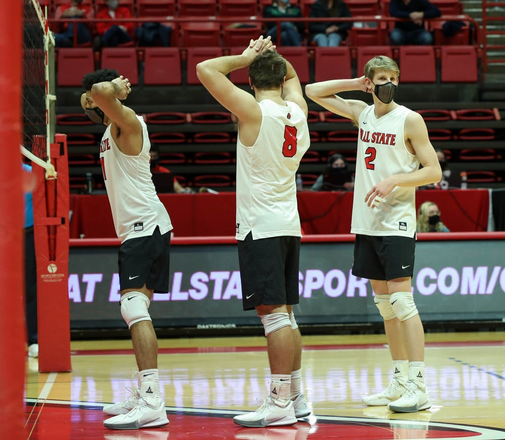 <p>Junior middle attacker Felix Egharevba, graduate student outside attacker Blake Reardon and junior outside attacker Kaleb Jenness wait for the ball to be served Feb. 20, 2021, at John E. Worthen Arena. Ball State won against the Lions 3-0. <strong>Jaden Whiteman, DN</strong></p>