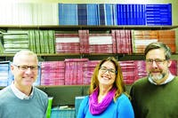 "Todd McKinney, Jill Christman, and Mark Neely (left to right) stand in front of the past issues of ""River Teeth,"" Jan. 13, 2020. ""River Teeth"" is a literary journal that publishes memoirs, essays, and other nonfiction narratives. Joshua Smith, DN"