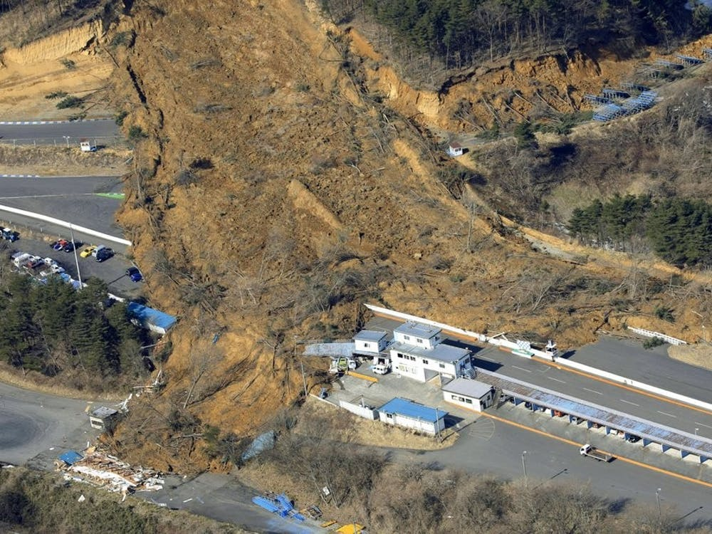 A landslide caused by a strong earthquake covers a circuit course in Nihonmatsu city, Fukushima prefecture, northeastern Japan, Sunday, Feb. 14, 2021. The strong earthquake shook the quake-prone areas of Fukushima and Miyagi prefectures late Saturday, setting off landslides and causing power blackouts for thousands of people. (Hironori Asakawa/Kyodo News via AP)