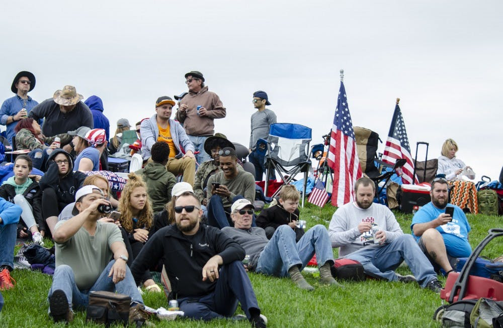 A viewing mound is filled with fans sitting on lawn chairs with blankets stretched out for a whole family for the IndyCar Grand Prix Saturday, May 11 at Indianapolis Motor Speedway. Fans and drivers alike believe the Grand Prix gets overshadowed by the Indy 500. Stephanie Amador, DN