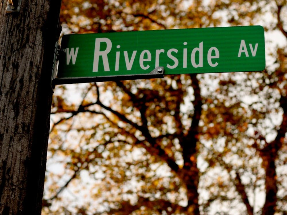 The sun shines on a Riverside street sign off of Ball States campus on Oct. 25 in Muncie, Ind. Thirteen IFC fraternity organizations, some housed on Riverside Avenue are under probation from hosting or co-hosting social events with or without alcohol until Jan. 31 after reports of behavior that does not follow university guidelines. Grace Hollars, DN