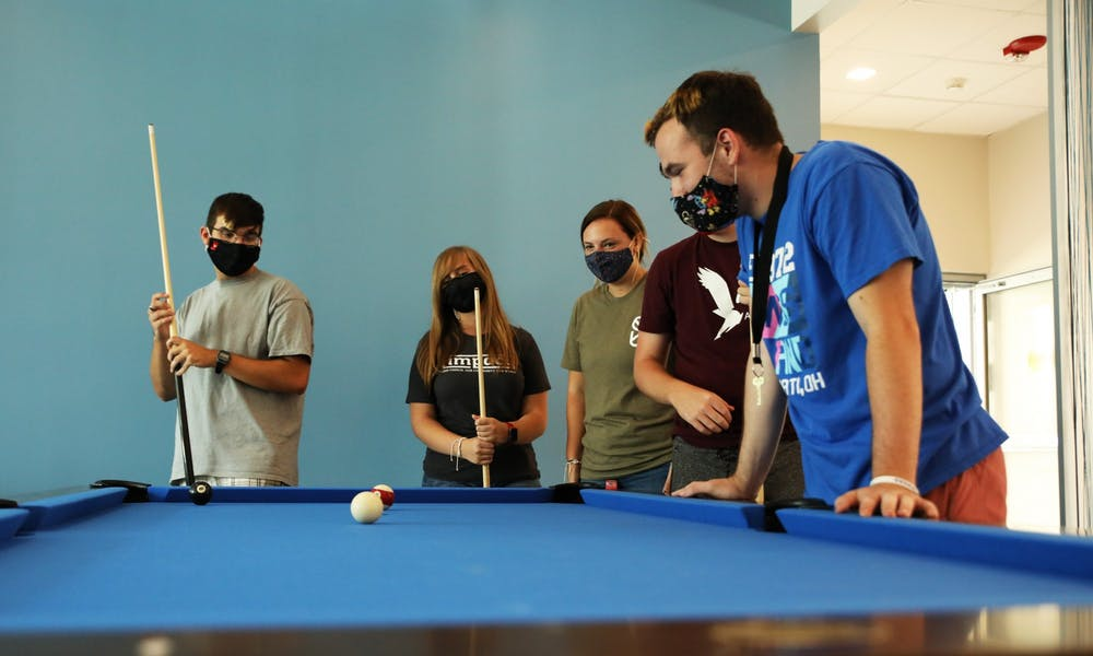 <p>Ball State students play pool, Aug. 20, 2021 inside the new North West Hall. The newly-opened residence hall is home to music, humanities and education living-learning communities. <strong>Rylan Capper, DN </strong></p>
