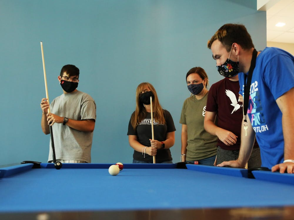 Ball State students play pool, Aug. 20, 2021 inside the new North West Hall. The newly-opened residence hall is home to music, humanities and education living-learning communities. Rylan Capper, DN