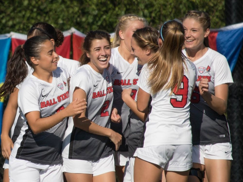 Ball State University players celebrate after Amanda Shaw scores in the second minute of the game against Eastern Michigan University at Briner Sports Complex on Oct. 13. Ball State won the game 3-0. Rebecca Slezak,DN File