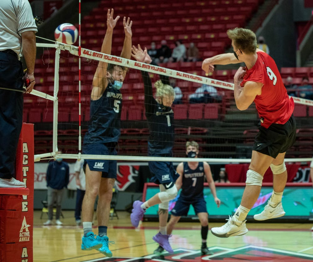 <p>Sophomore outside attacker Bryce Behrendt sends the ball over the net Jan. 29, 2021, in John E. Worthen Arena. Behrendt had 10 kills against Lincoln Memorial University. <strong>Jaden Whiteman, DN</strong></p>