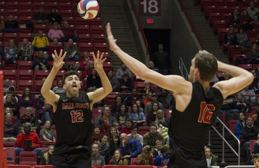 <p>Ball State men's volleyball player Jake Romano, 12, sets up the ball for Matt Walsh, 16, to spike it during the first game against Loyola University on Feb. 17 at John E. Worthen Arena. &nbsp;Loyola was the second top 10 opponent that Ball State defeated. <strong>Briana Hale, DN</strong></p>
