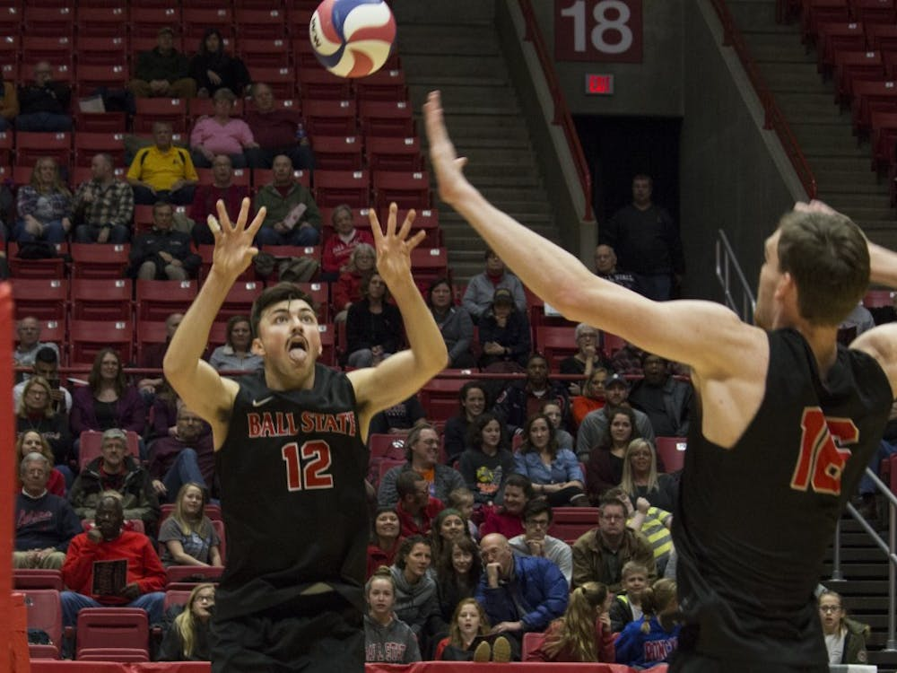 Ball State men's volleyball player Jake Romano, 12, sets up the ball for Matt Walsh, 16, to spike it during the first game against Loyola University on Feb. 17 at John E. Worthen Arena.  Loyola was the second top 10 opponent that Ball State defeated. Briana Hale, DN