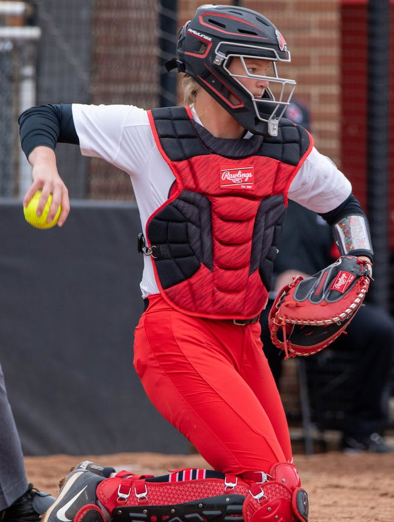 Senior catcher Stacy Payton throw the ball to the pitcher March 26, 2021, at the Softball Field at First Merchants Ballpark Complex. The Cardinals won 8-6 against the Falcons. Jaden Whiteman, DN