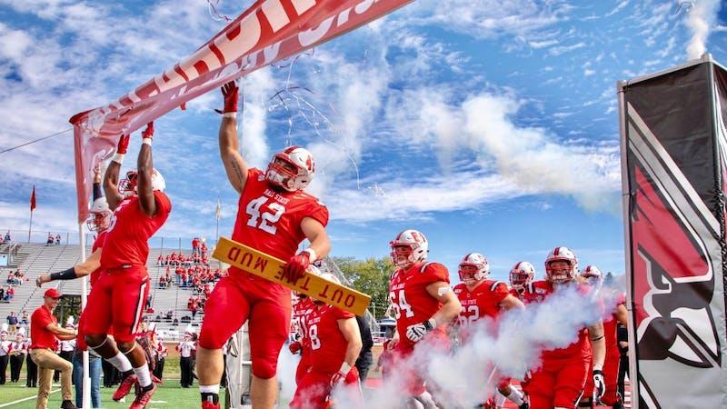 Senior defensive tackle Chris Crumb smacks the banner as he runs onto the field Oct. 19, 2019, at Scheumann Stadium. Ball State beat Toledo, 52-14. Jacob Musselman, DN