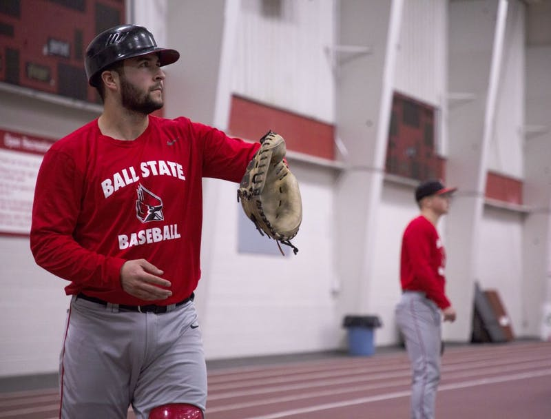 Redshirt junior catcher Chase Sebby warms up before practice Jan. 30, 2019, in the Field Sports Building. Sebby played in 40 games at Cypress College before coming to Ball State. Zach Piatt, DN