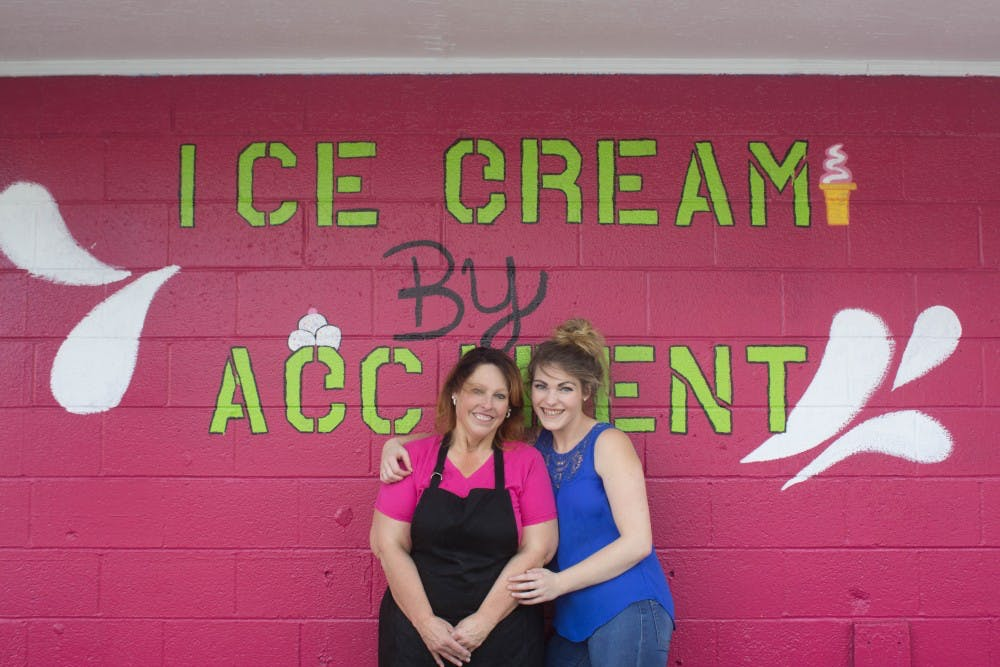 Terry Budaj and Amber White standing out front of their ice cream shop on Tuesday, Sept. 11, 2018, at the location of 1231 South Walnut Street Munice, IN. Terry and Amber just started this business and are looking forward to a successful future. Alex Straw,DN