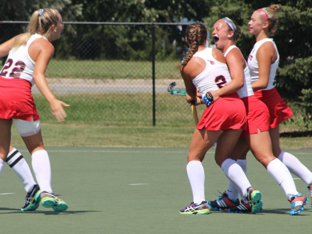 Ball State field hockey players celebrate after senior midfielder Carley Shannon scored a goal in the first half of the Cardinals' game against Ohio on Aug. 27 at Briner Sports Complex. Ball State scored two goals in the first half. Patrick Murphy // DN