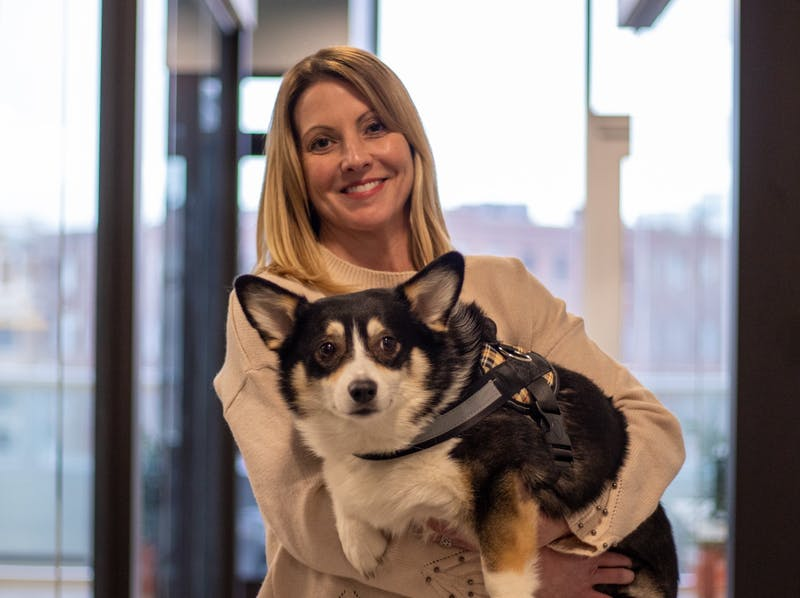 "Kimberly Jeselski stands with her ""office dog"" Babette Jan. 17, 2020, in Indianapolis Ind. Babette stays in Jeselski's office but will wander around the office space and sometimes into other people's offices. Jacob Musselman, DN"