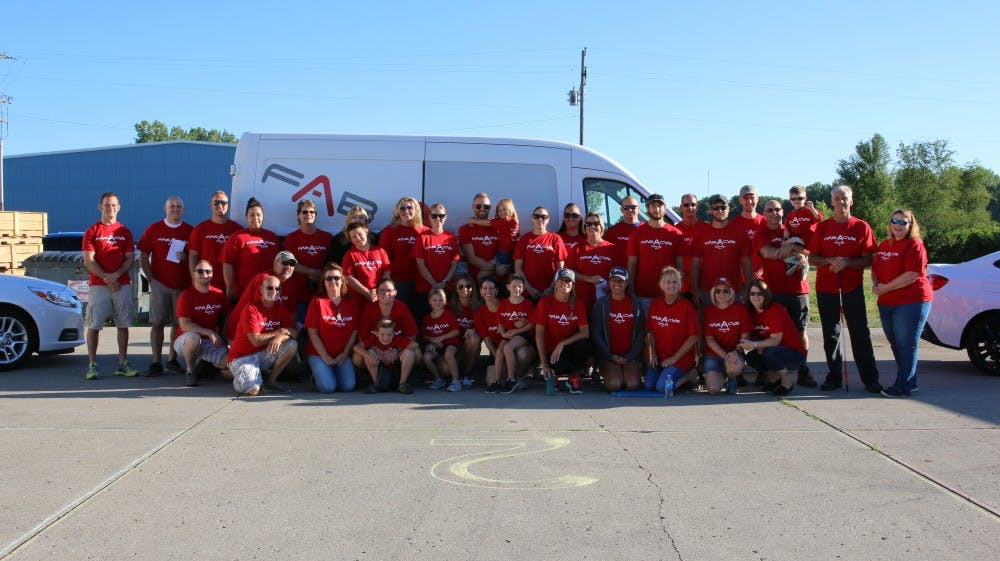 Members of the Middletown, Ind. community and staff of FAB-A-CAB rallied for a quick group photo before starting the day of service event.