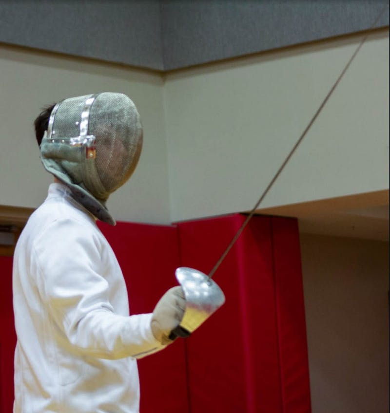 Junior Spencer Deats prepares to take on an opponent during a Ball State fencing club practice at the Ball State Student Recreation and Wellness Center. Patrick Murphy, DN