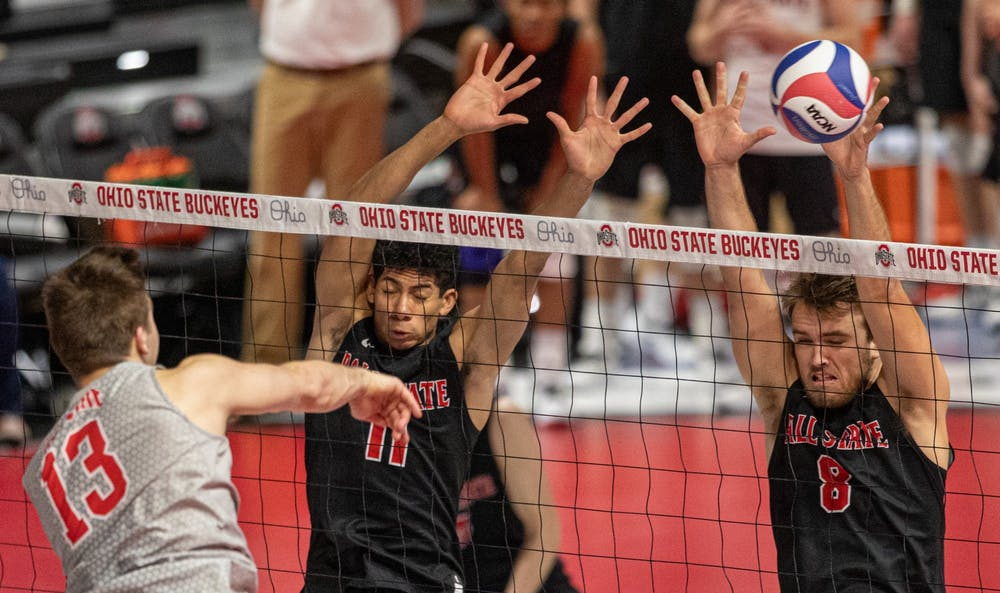 <p>Redshirt junior outside hitter Tyler Alter spikes the ball into senior outside attacker Blake Reardon March 4, 2020, at the Covelli Center in Columbus, Ohio. Reardon had six kills against the Buckeyes. <strong>Jacob Musselman, DN</strong></p>