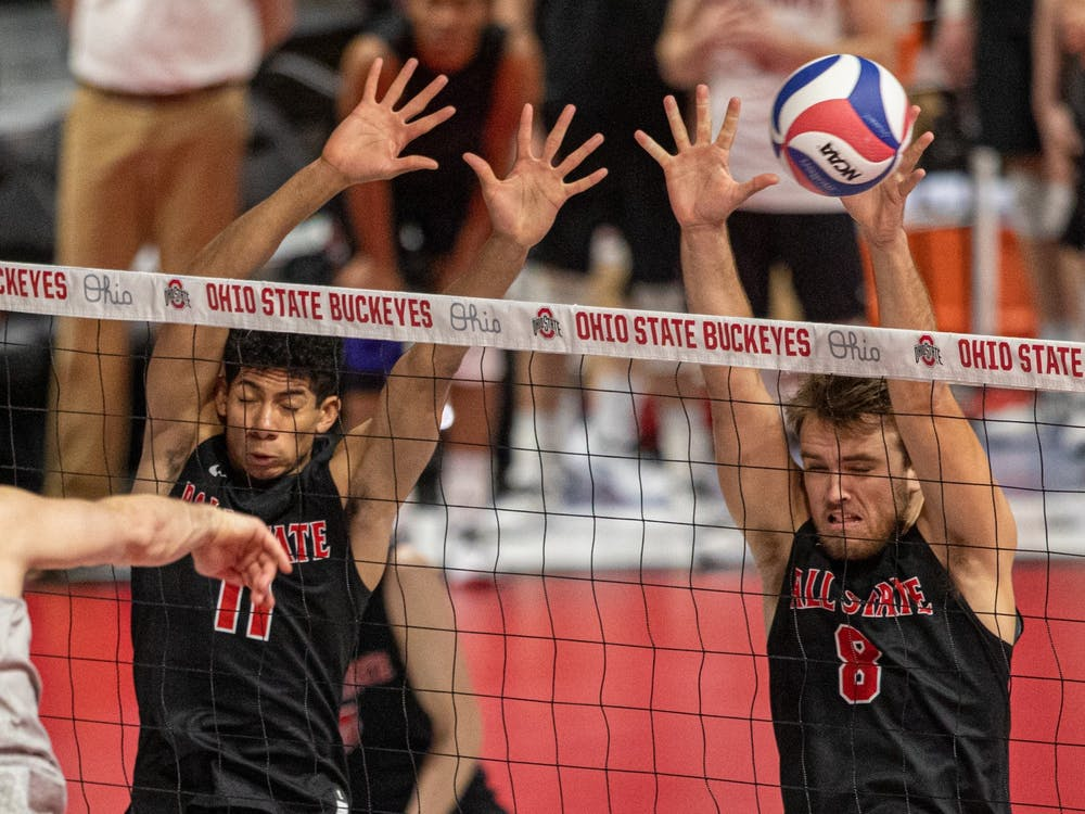 Redshirt junior outside hitter Tyler Alter spikes the ball into senior outside attacker Blake Reardon March 4, 2020, at the Covelli Center in Columbus, Ohio. Reardon had six kills against the Buckeyes. Jacob Musselman, DN