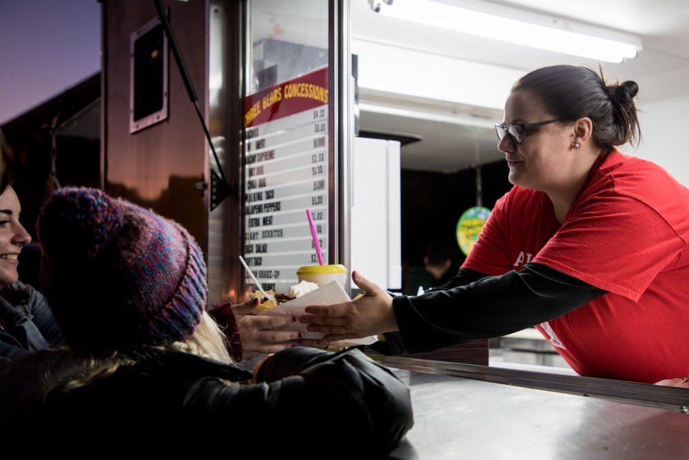 Ball State Students get nachos from Three Bears Concessions Oct. 14, 2019, at Food Truck Fest in the village. Food Truck Village was the first of several events for Ball State's Homecoming week. Eric Pritchett, DN