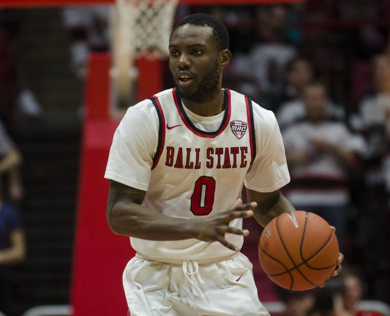 Senior guard Francis Kiapway looks to pass the ball during the Cardinals' game against Eastern Michigan on Feb. 21. The Cardinals first game is Nov. 10 at Dayton. Emma Rogers, DN File
