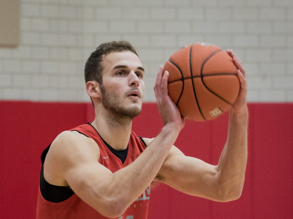 Senior Kyle Mallers shoots three-pointers before practice Oct. 29, in the Dr. Don Shondell Practice Center. Mallers has played in every game in his first three years at Ball State. Eric Pritchett, DN
