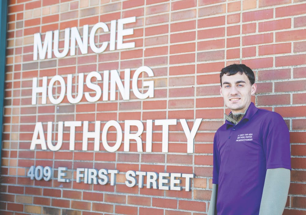 <p>Ball State social work major Matt Peiffer poses for a photo outside the Muncie Housing Authority building March 7, 2021. Peiffer has been lobbying the Muncie Housing Authority since August 2019 to accept Foster Youth to Independence vouchers. <strong>Jaden Whiteman, DN</strong></p>