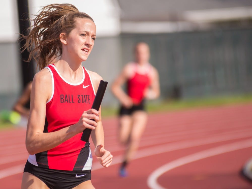 Freshman Amber Jones runs the 4x400 m relay during the Ball State Challenge on April 15 at Briner Sports Comlex. Ball State finished fourth place. Terence K. Lightning Jr. // DN