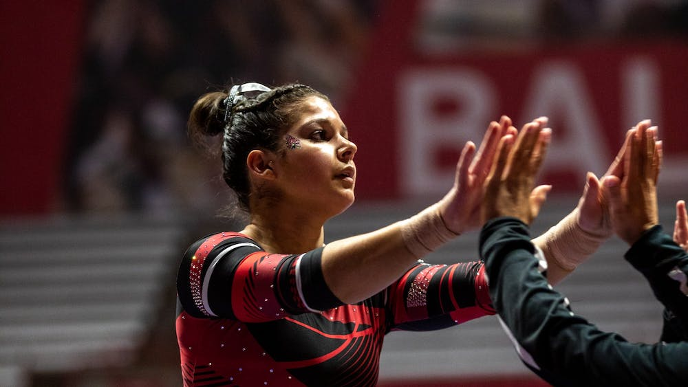 Ball State Senior, Rachel Benoit high fives her teammates as she completes the beam routine during the women's gymnastics home opener, Jan. 26, 2020 in John E. Worthen Arena. The Cardinals secured a win by putting up 194.2 points. Paul Kihn, DN