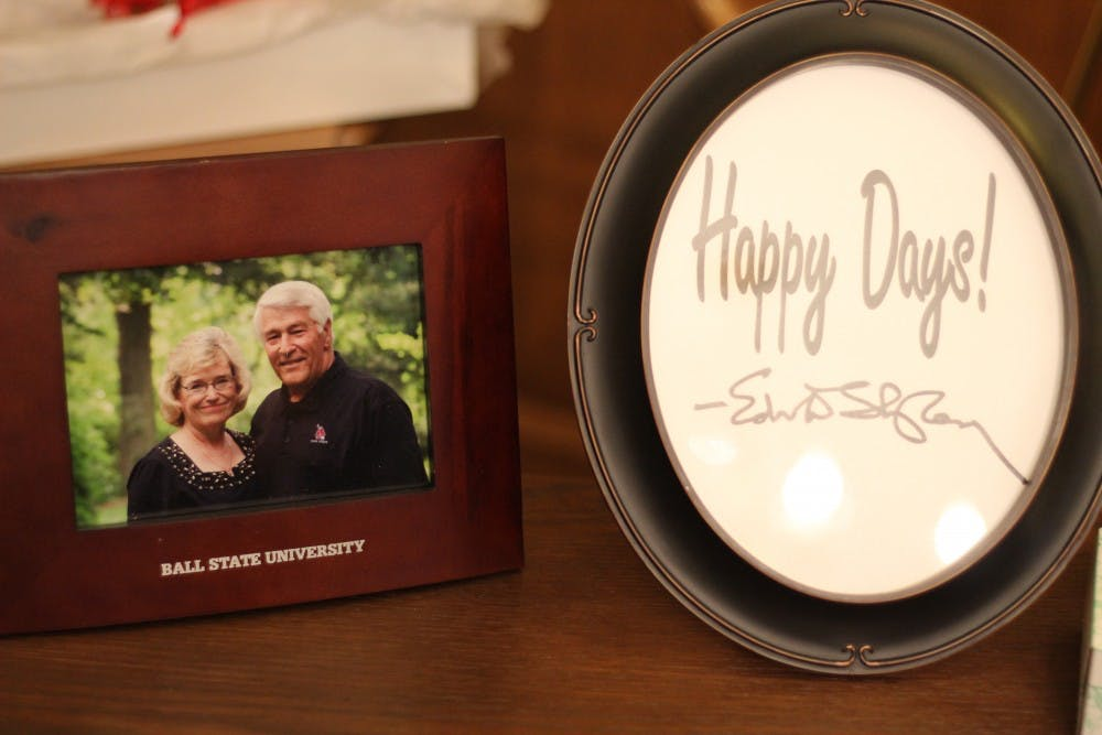 A photo of Ed Shipley, former president and CEO of Ball State's Alumni Association, and his wife Vicki Shipley and a framed signature of his rests on a table at his viewing May 21, 2019, at Parson Mortuary. Friends and family reflected in Shipley's life during his viewing. Britney S. Kendrick, DN