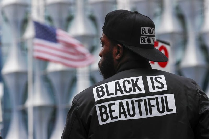 A protester stands in front of the US embassy during the Black Lives Matter protest rally June 7, 2020, in London in response to the recent killing of George Floyd by police officers in Minneapolis, USA, that has led to protests in many countries and across the US. (AP Photo/Frank Augstein)