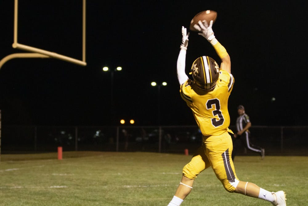 <p>Monroe Central player catches the ball in the touchdown zone to score a touchdown on September 27th, 2019 against Wes-Del High School. Monroe Central won the game 41-12. Jaden Whiteman, DN</p>