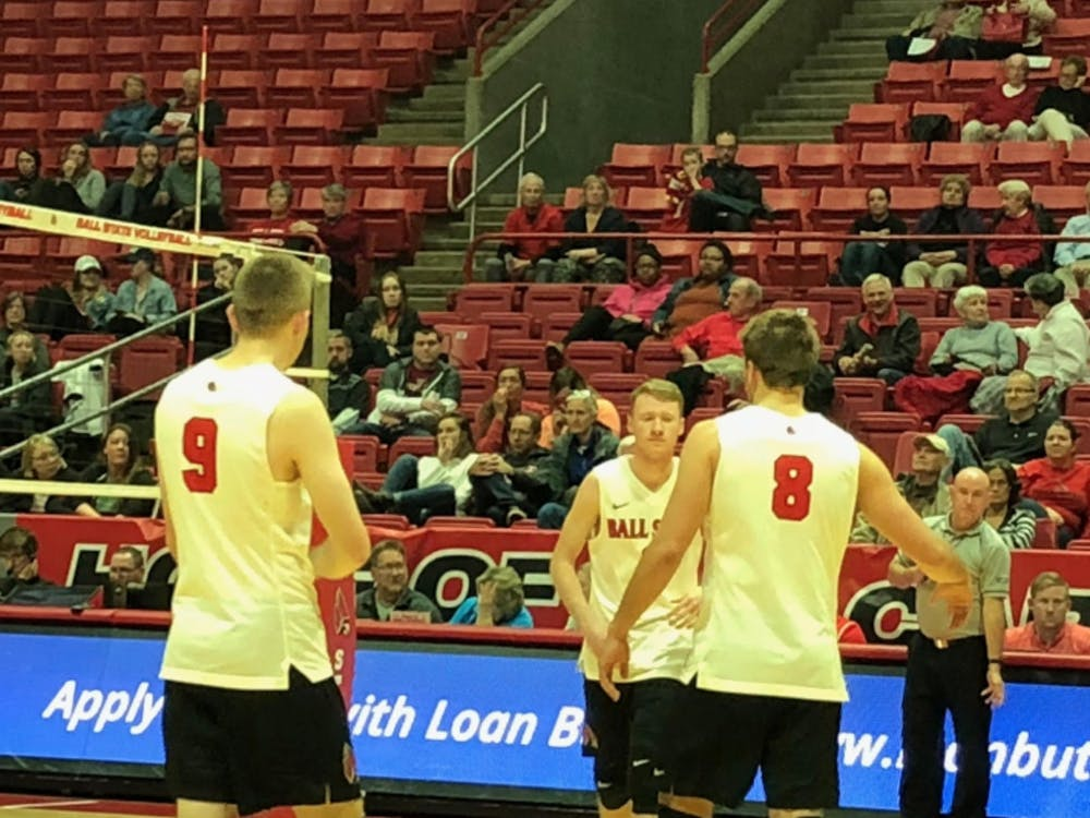 Parker Swartz, Ben Chinnici and Blake Reardon celebrate during the Cardinals' match against UC-Irvine Jan. 7 in Worthen Arena. Ball State lost the match 3-0. Connor Smith, DN