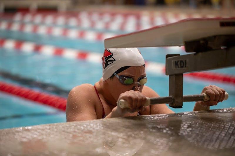 Senior Anne Vormohr takes her mark in the 100-Backstroke Jan. 16, 2020, in Lewellen Aquatics Center. The Cardinals won 193-105. Jacob Musselman, DN