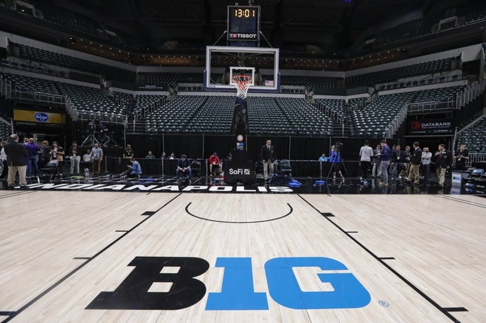<p>The seating area at Bankers Life Fieldhouse is empty as media and staff mill about, Thursday, March 12, 2020, in Indianapolis, after the Big Ten Conference announced that remainder of the men's NCAA college basketball games tournament was cancelled. <strong>(AP Photo/Michael Conroy)</strong></p>