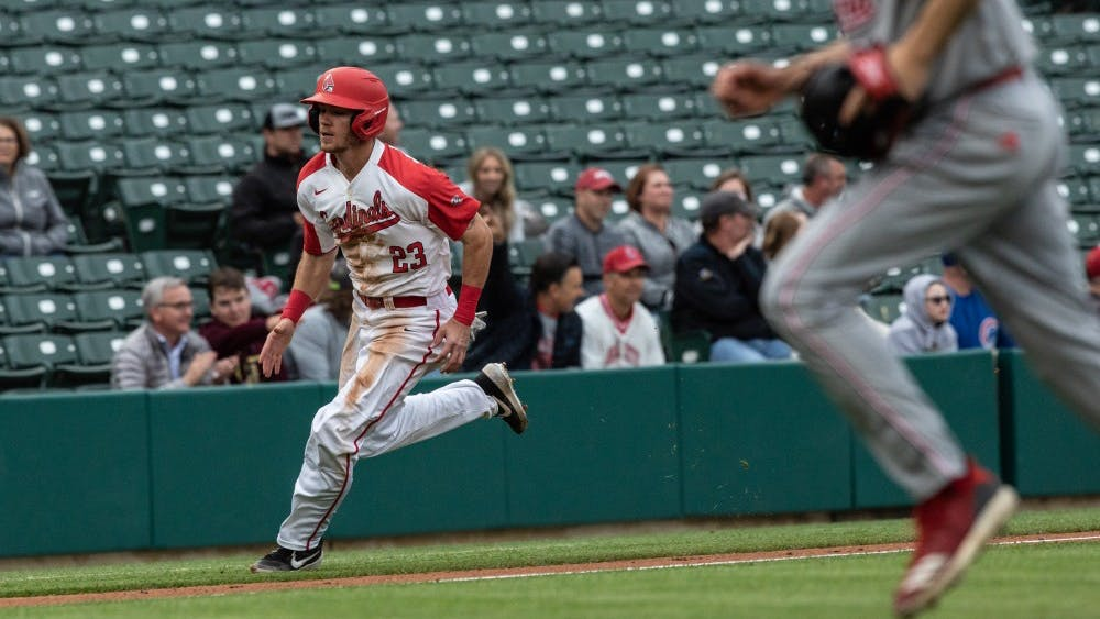 Junior right fielder Ross Messina rounds third base to score at home third inning at Victory Field in Indianapolis April 23, 2019. Messina was the only Cardinal to have multiple hits in the game. Rebecca Slezak, DN