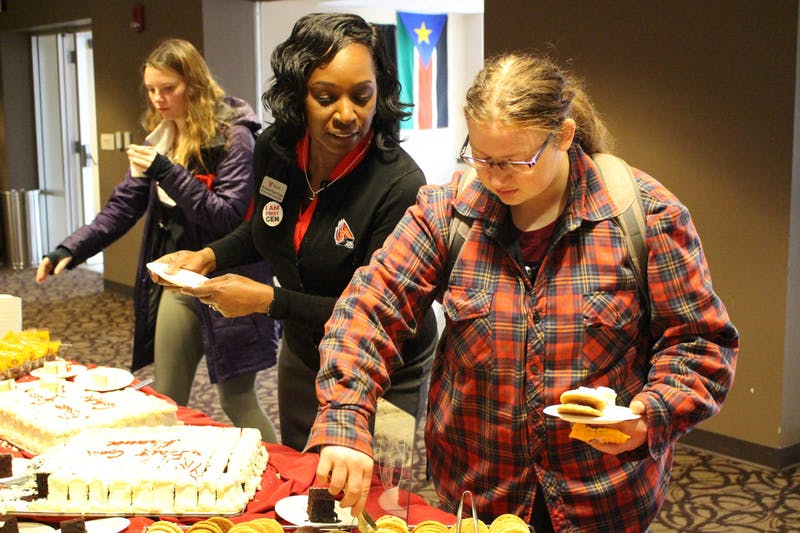 """Ro-Anne Royer Engle, interim vice president for student affairs, talks with a student Nov. 8, 2019, at the Student Center Terrace Lounge. Ball State Student Affairs offered cake, cookies, punch and goodies for attendees at its """"I Am First Generation Celebration"""" event. Bailey Cline, DN"""